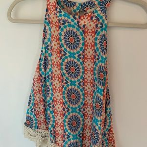 Boutique tank top with lace on bottom